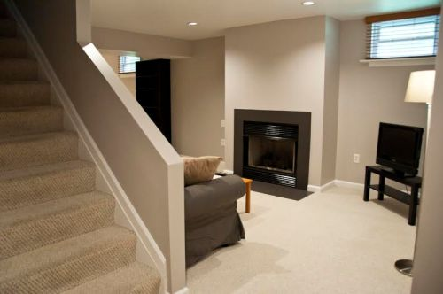 From the base of the interior stairway, your entrance to the living, dining, and kitchenette area.